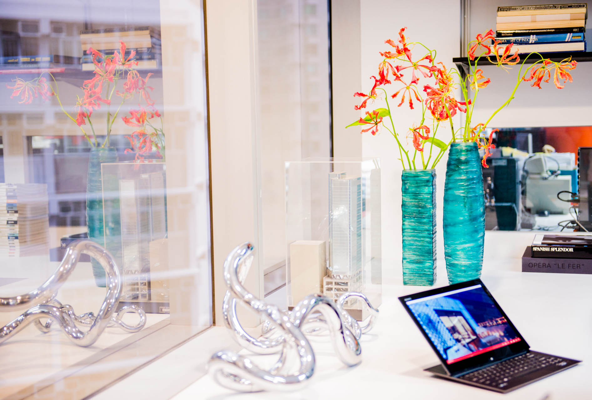 A laptop screen sits on a counter by the window showcasing one of DCMStudios signature retail designs.